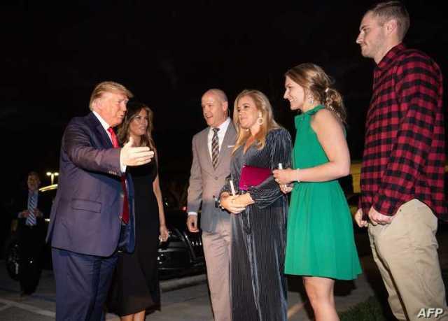 US President Donald Trump (L) and First Lady Melania Trump (2nd L) greet Lead Pastor Jimmy Scroggins (3rd L), his wife Kristin …