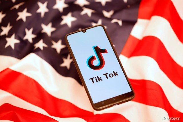 Tik Tok logo is displayed on the smartphone while standing on the U.S. flag in this illustration picture taken, November 8,…