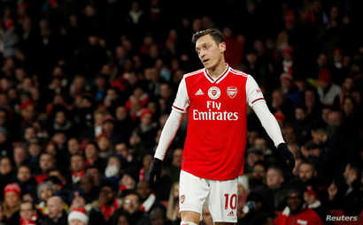 FILE - Arsenal's Mesut Ozil is seen at a Arsenal v Manchester City match, at Emirates Stadium, London, Britain, Dec. 15, 2019.