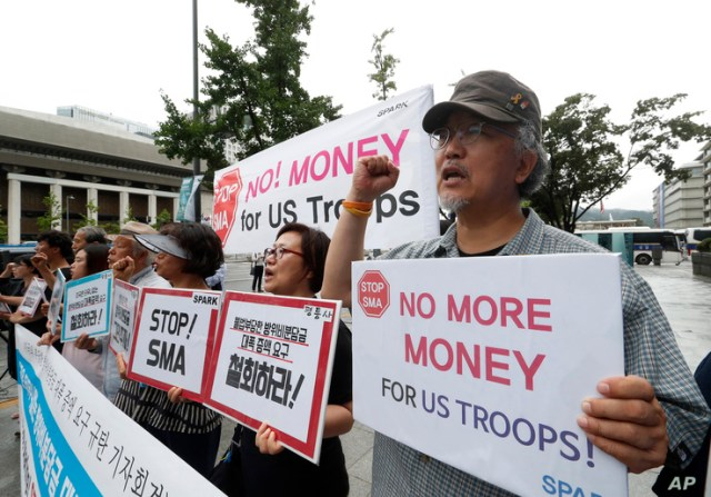 South Korean protesters shout slogans during a rally demanding withdrawal of the U.S. troops from Korea Peninsula near the U.S. embassy in Seoul, South Korea, July 31, 2019.