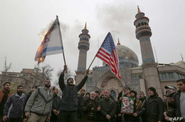 Iranians burn an Israeli and a U.S. flag during an anti-U.S. protest in the capital Tehran, Jan. 4, 2020, over the killings of Iranian military commander Qasem Soleimani and Iraqi paramilitary chief Abu Mahdi al-Muhandis.