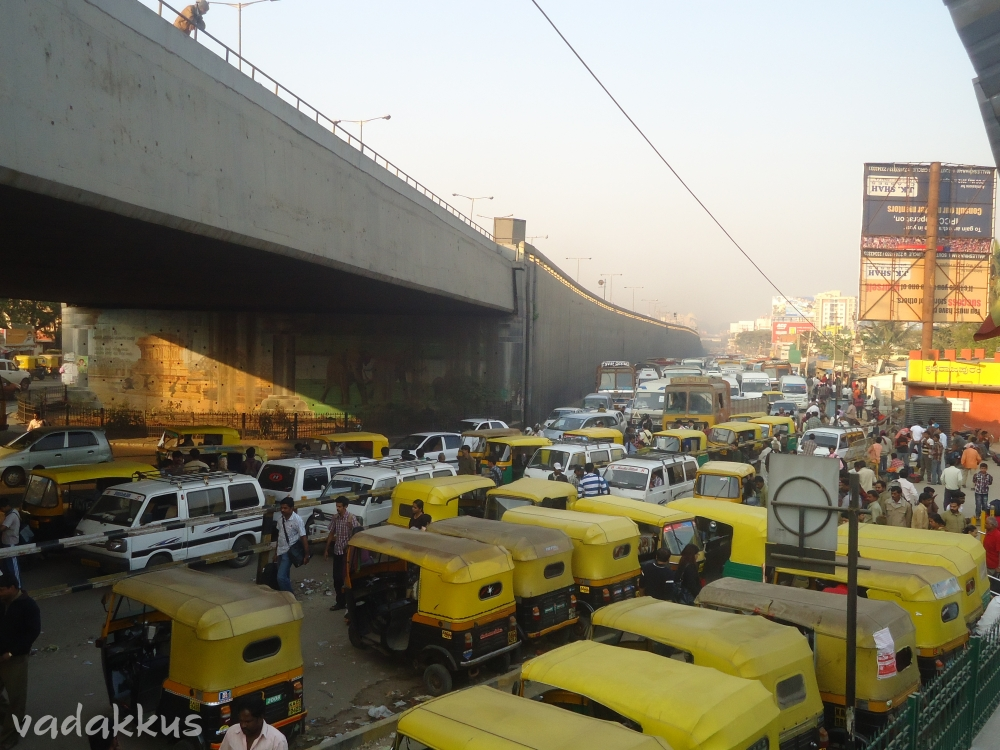 "Traffic jam under the ""hanging bridge"" at KR Puram in front of the Railway Station"