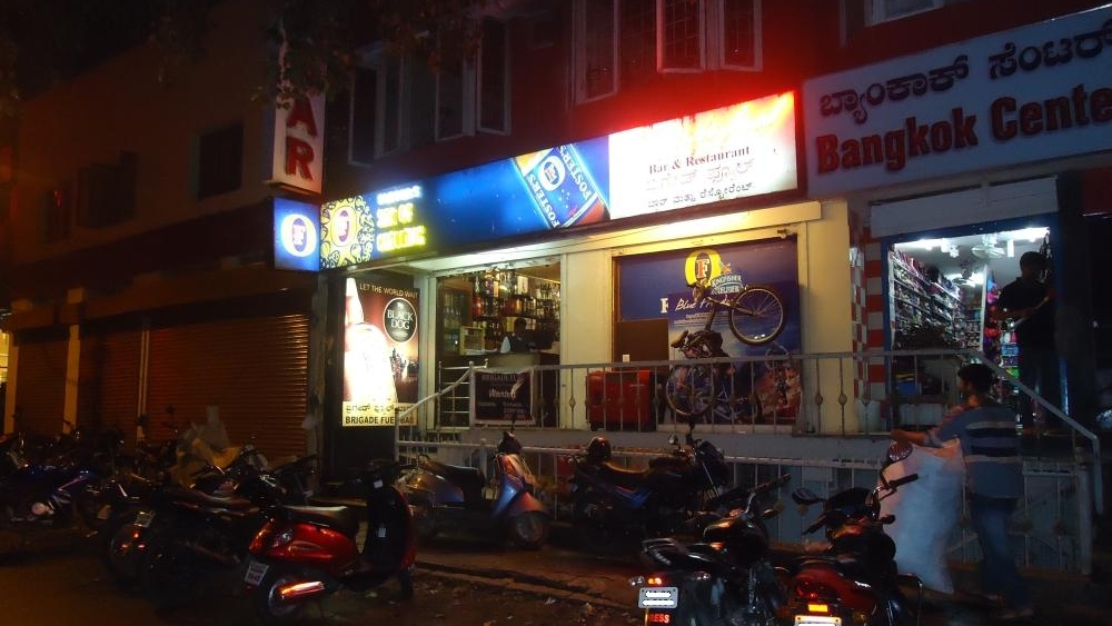 Brigade Fuels, a local liqor store on Resthouse road off Brigade Road, Bangalore, at night.