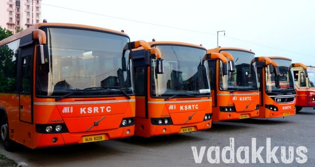 Group of Orange Volvo low floor city buses at Ernakulam