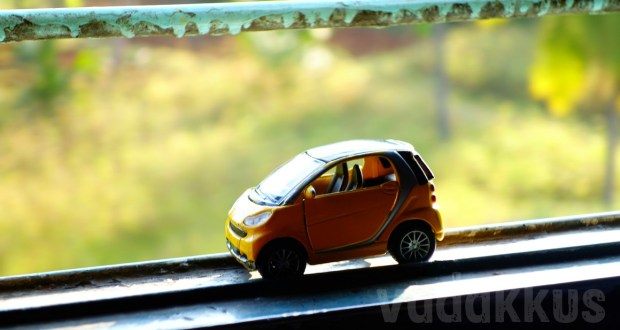 A toy Smart car on a Indian train's window sill. Wxample for Macro Photography
