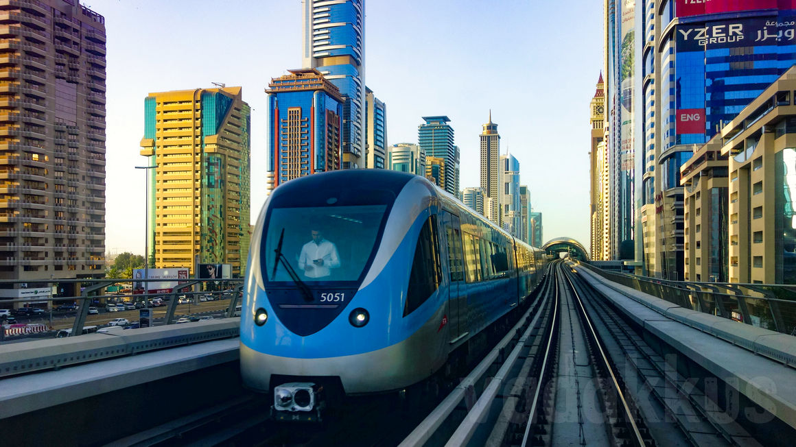 The Dubai Metro train seen on top of the viaduct running along the main part of Sheikh Zayed Road, just before the Financial Center Metro Station