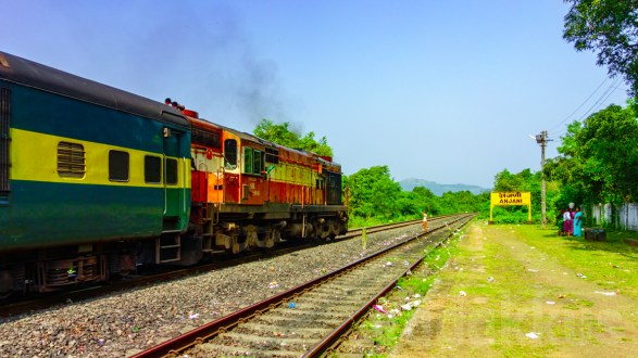 Ernakulam's Orange Hunk Hauls the Garib Rath on the Konkan Railway