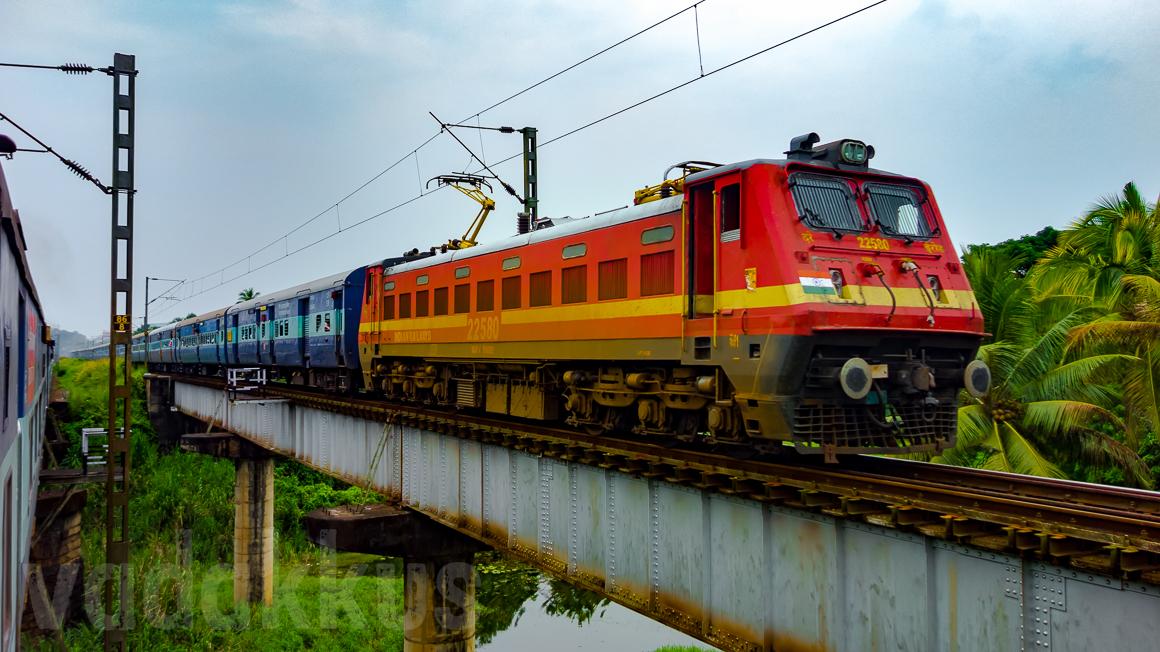 A beautiful picture of a train on a girder bridge in kerala, india. wap4 22580 Sabari Express