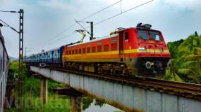 The Parasuram Express on a Girder Bridge in a Wet and Green Kerala