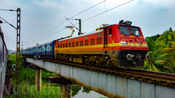 The Parasuram Express on a Girder Bridge in a Wet and Green Kerala