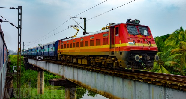 A beautiful picture of a train on a girder bridge in kerala, india. wap4 22580 Sabari Express