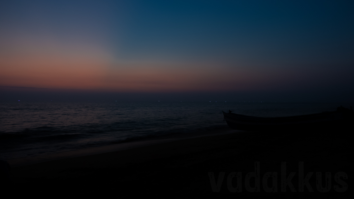 Lonely Beach at Dusk evening after sunset with boat