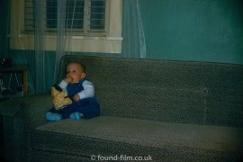 Child on sofa