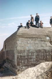 Schoolboys posing on a monument
