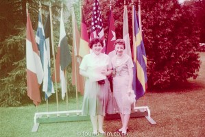 Portrait in front of flags