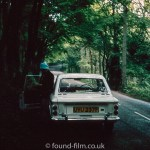 Hillman Imp coupe under trees