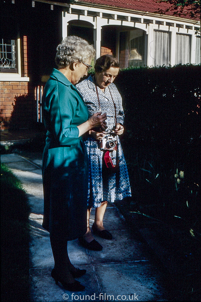 Two ladies with camera