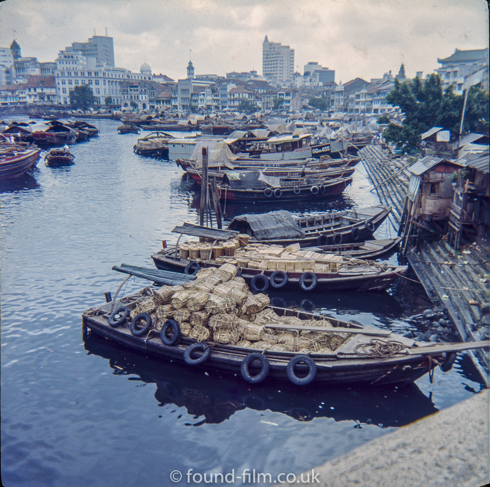 Boats Quay on the Singapore river early 1960s