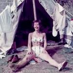 Woman 2 outside tent