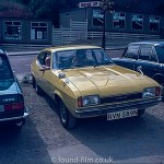 Yellow ford capri from 1974 parked in the street