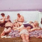 A Seaside group behind a windbreak