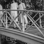 Two young ladies on a bridge in the 1920s