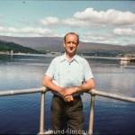Waterside portrait of a man by a lake