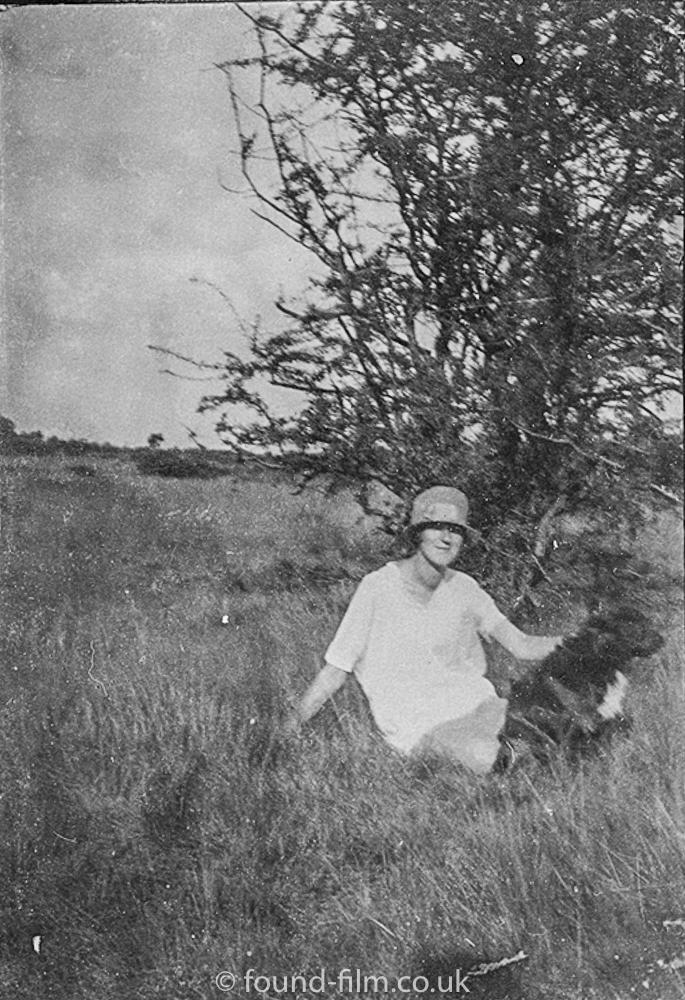 Woman and her dog in the countryside.