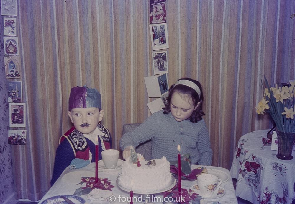 Children eating cake at Christmas
