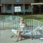 Woman by a swimming pool, August 1967