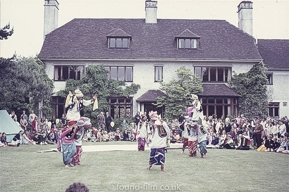 An oriental dance group on a lawn