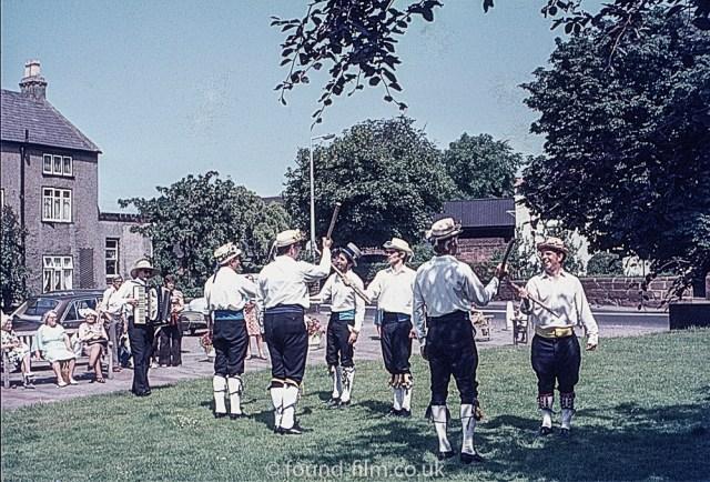 Morris men dancing with poles