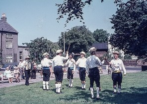 Morris men dancing with poles