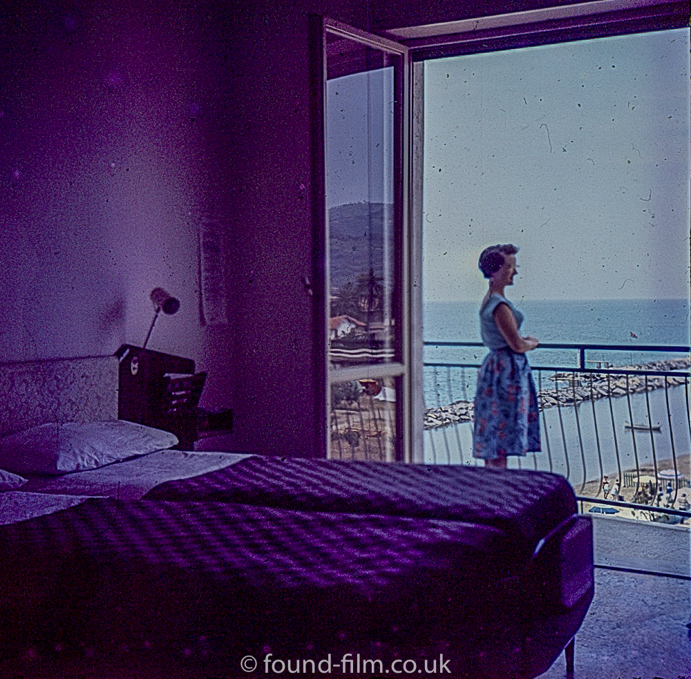 Hotel Bedroom with woman on Balcony