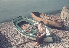 Woman sitting on the side of a boat