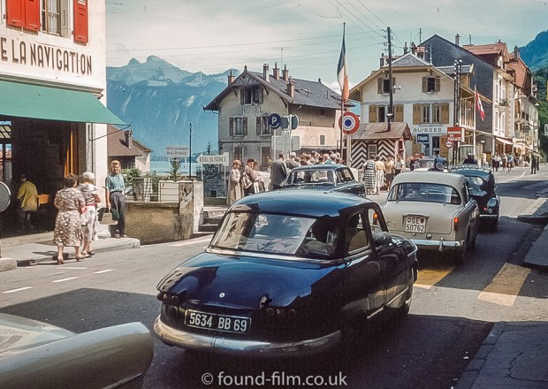 Cars lined up at the French-Swiss border, 1950s