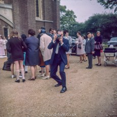 A Man at a wedding with a camera