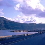 A Kodachrome slide of the view down the main road at Ullapool showing the fishing quay and bay