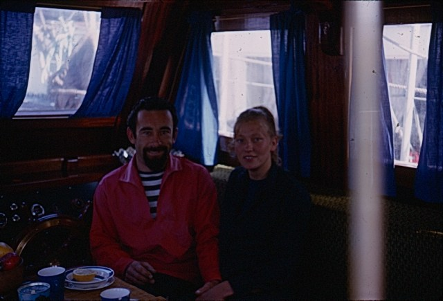 A Kodachrome slide showing dark portrait of a couple on a boat - Jun 1965