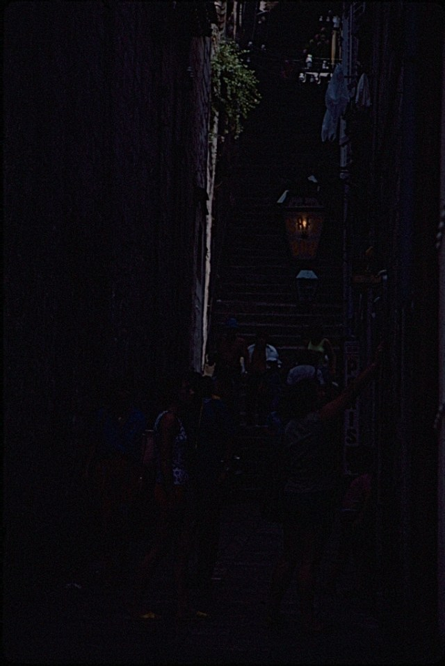 Severely under exposed Kodachrome slide of people in a narrow alleyway with steps