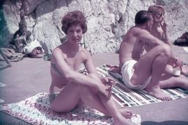 A Pretty girl sitting on a towel with a cigarette in Plymouth Royal Citadel