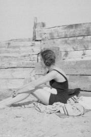 Black & White picture of a girl on a beach in about 1930