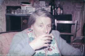 Lady having a quiet drink c1955