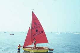 Woman and child with a sailing dinghy - 1960s