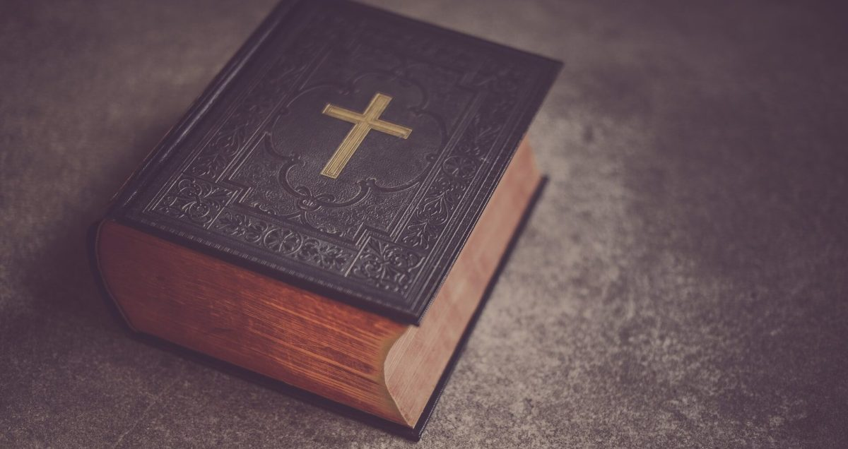 Old bible with a cross on the cover