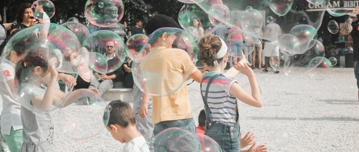 kids playing with large bubbles