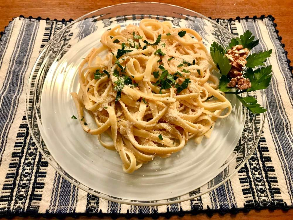 """Adapted from the 12 Best Foods cookbook, this hearty pasta dish features antioxidant-rich walnuts, which have been touted as anti-inflammatory and helpful in reducing """"bad"""" cholesterol and improving gut health, among other benefits. And who knew that mixing goat cheese with pasta cooking water would create the perfect creamy sauce?"""