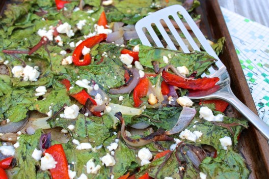 Crave-worthy greens are easy thanks to this unique method of preparation that delivers crisps edges and golden brown bits of feta...all while adding a few other veggies to the mix!