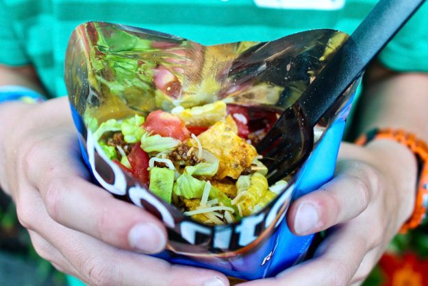 Walking Tacos offer a fun, portable way to enjoy the traditional taco salad and are perfect for kids' parties and casual dinners. Those who prefer a plated version may absolutely eat the meal that way.