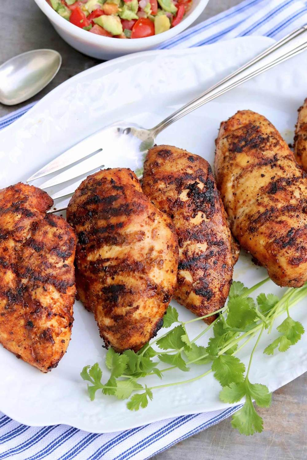 Sazón Grilled Chicken - This little spice packet (or the easy homemade option) adds incredible flavor when used as a rub for grilled chicken!